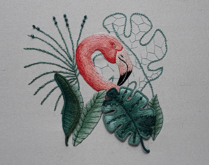 Completed flamingo embroidery, worked in silk shading with stumpwork leaves.