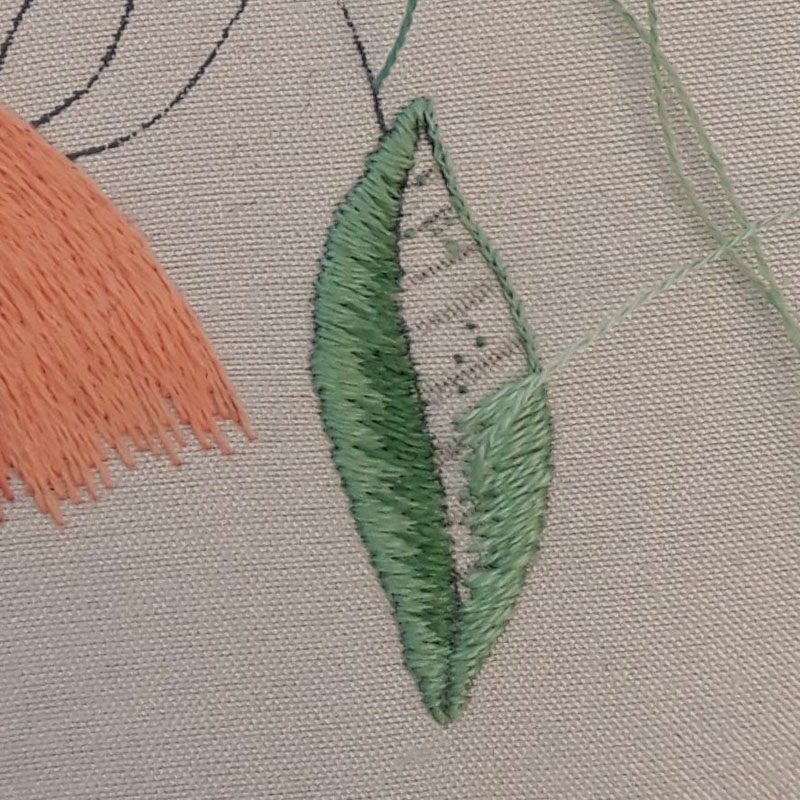 Work in progress silk shaded leaf. The long and short stitches are worked over a split stitch foundation.