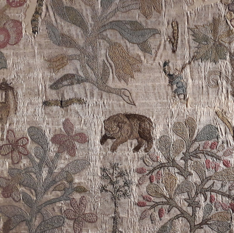 Close up of Bacton alter cloth showing a small bear motif in between larger floral motifs.