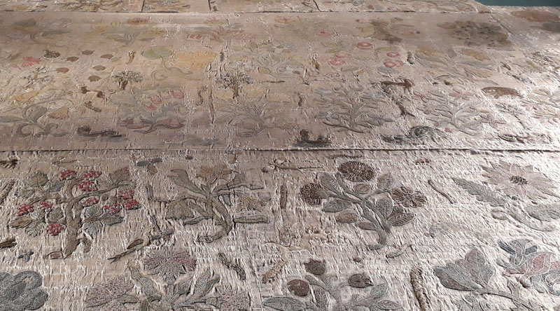 A section of the Bacton altar cloth where the small motifs seem to connect to tell a story.