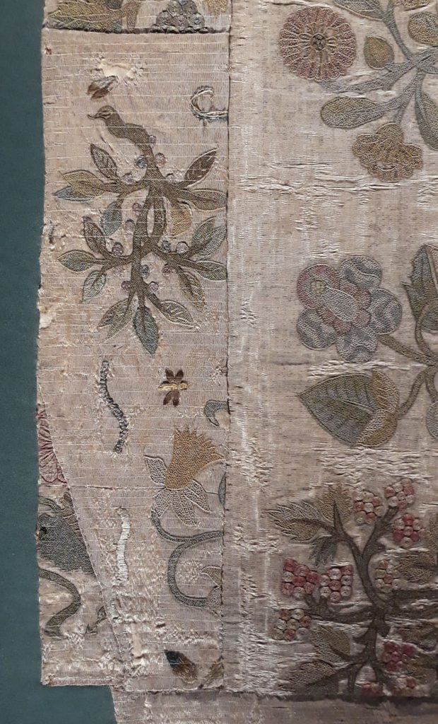 Panels of Elizabeth I's dress sewn into the Bacton altar cloth. The diagonal cut and size of the piece is the same as would be used to cut a dress bodice.