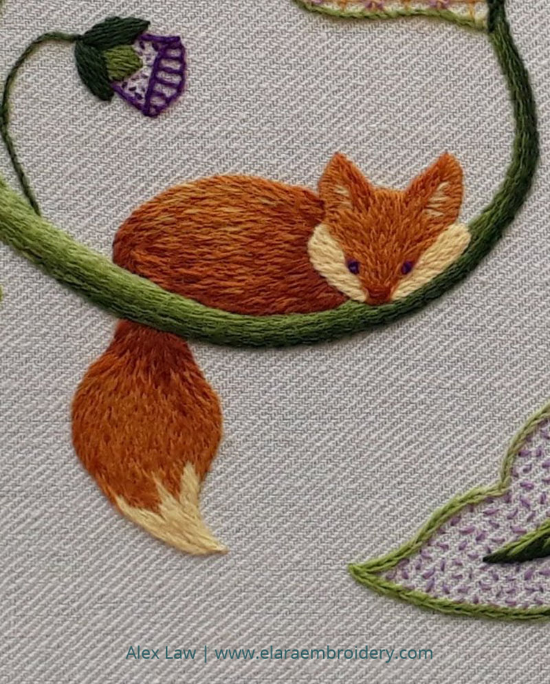 Close up view of crewelwork fox using the silk shading technique.