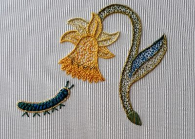 My completed embroidery of a daffodil and caterpillar.