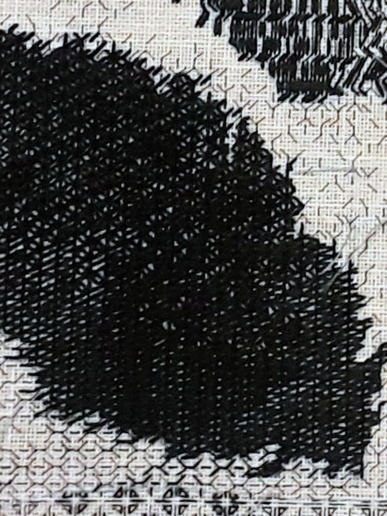 Close up of my blackwork piece showing where I blended between two blackwork stitch patterns.