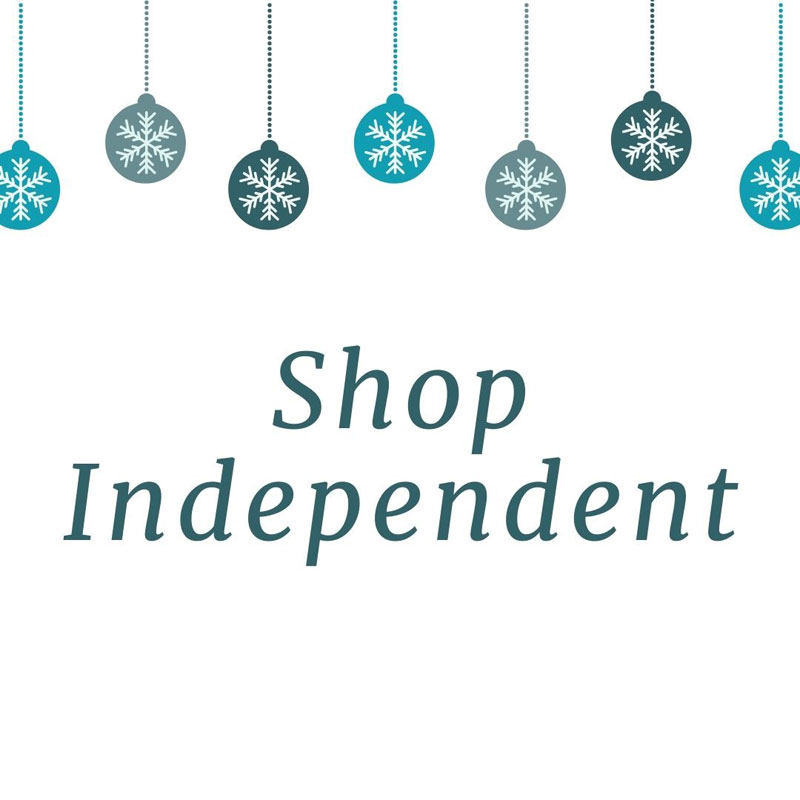 "The text ""Shop Independent"" below a row of Christmas baubles."