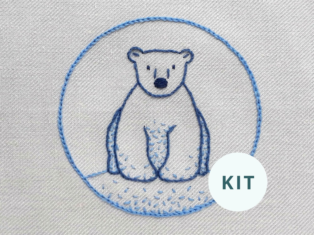 Image of the completed cute polar bear crewel embroidery kit.