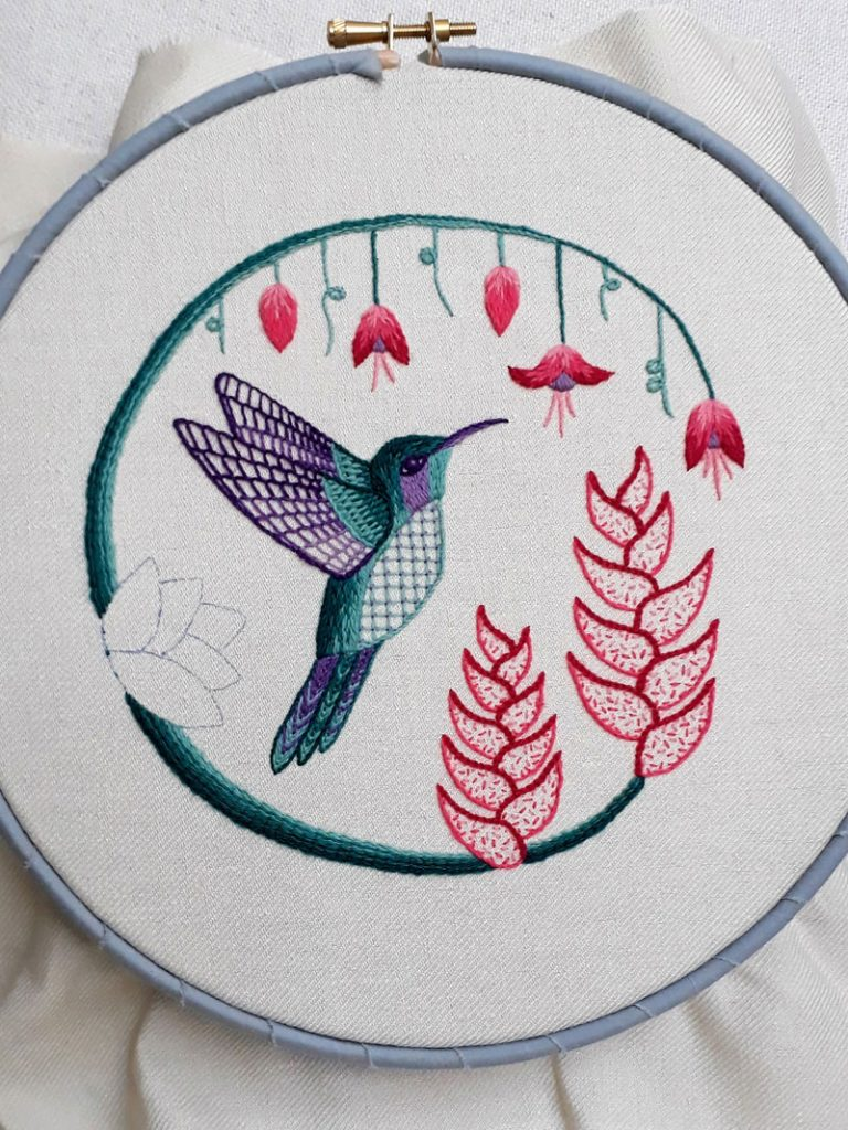 My hummingbird embroidery in a hoop. All is stitched except for one flower.