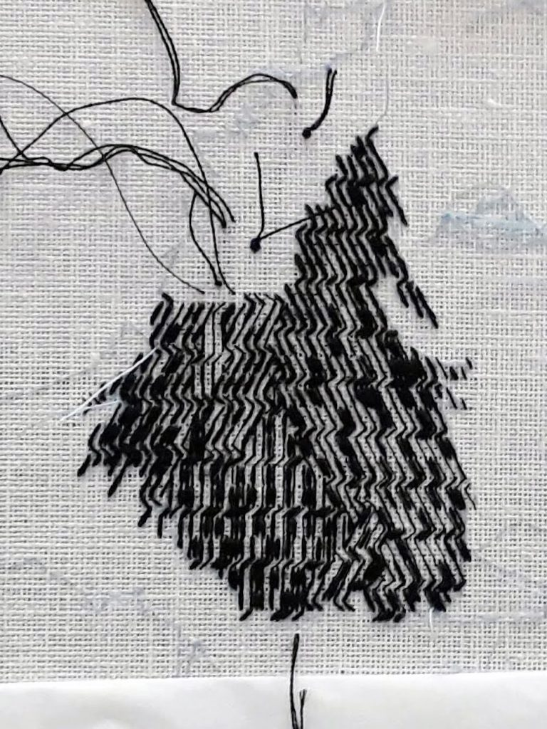 The ear now has 3 rotations of the blackwork pattern and random additional stitches are being added to create the texture.
