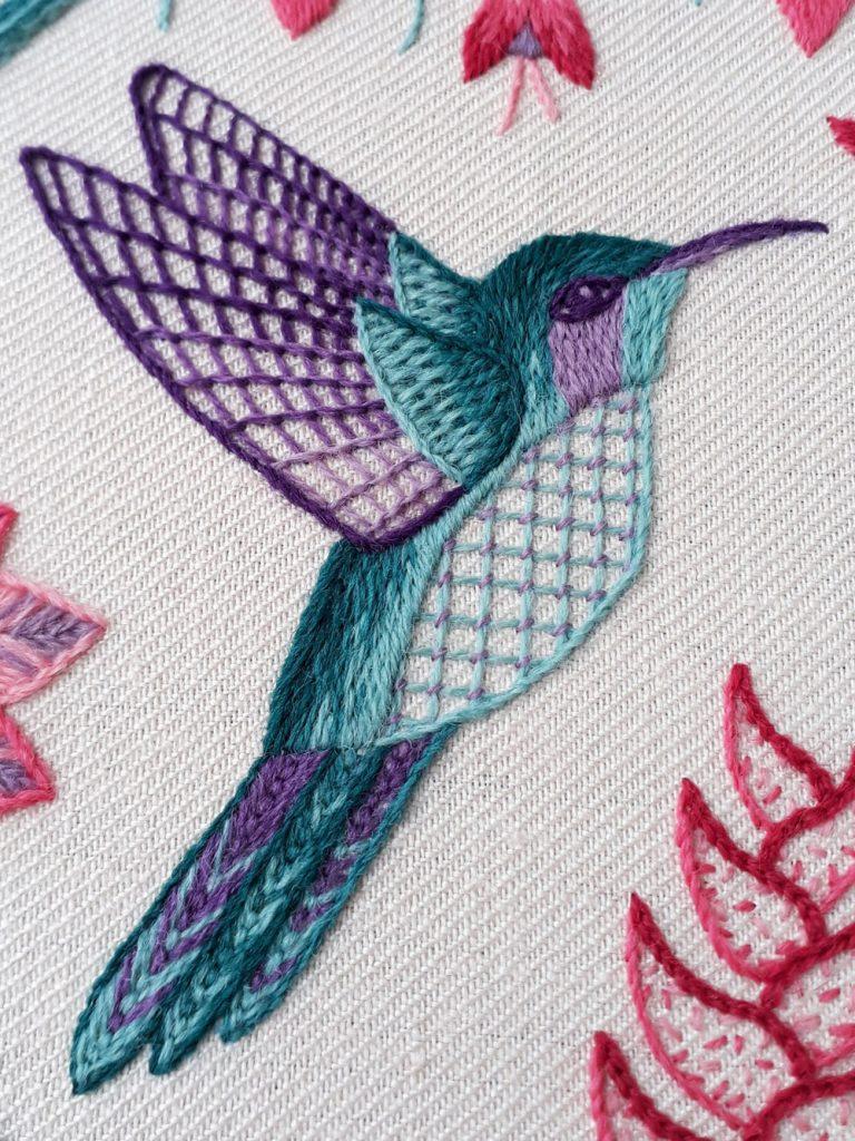 Crewel embroidery green and purple hummingbird.