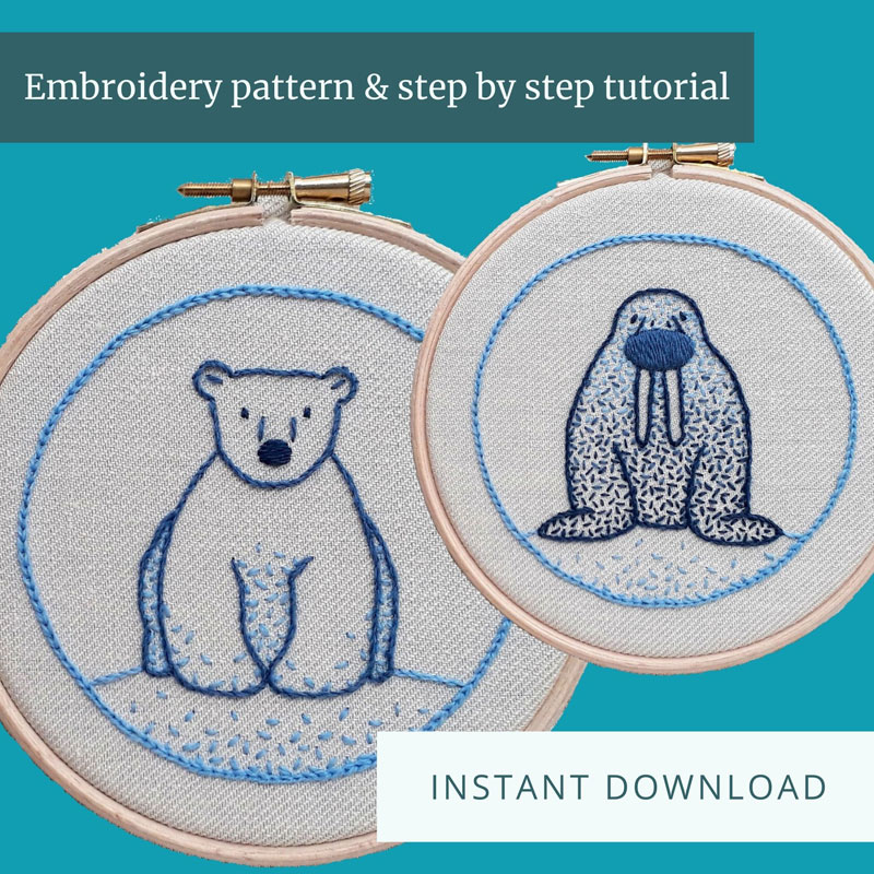 Crewelwork embroideries of a polar bear and a walrus, stitched in shades of blue thread, both in embroidery hoops.
