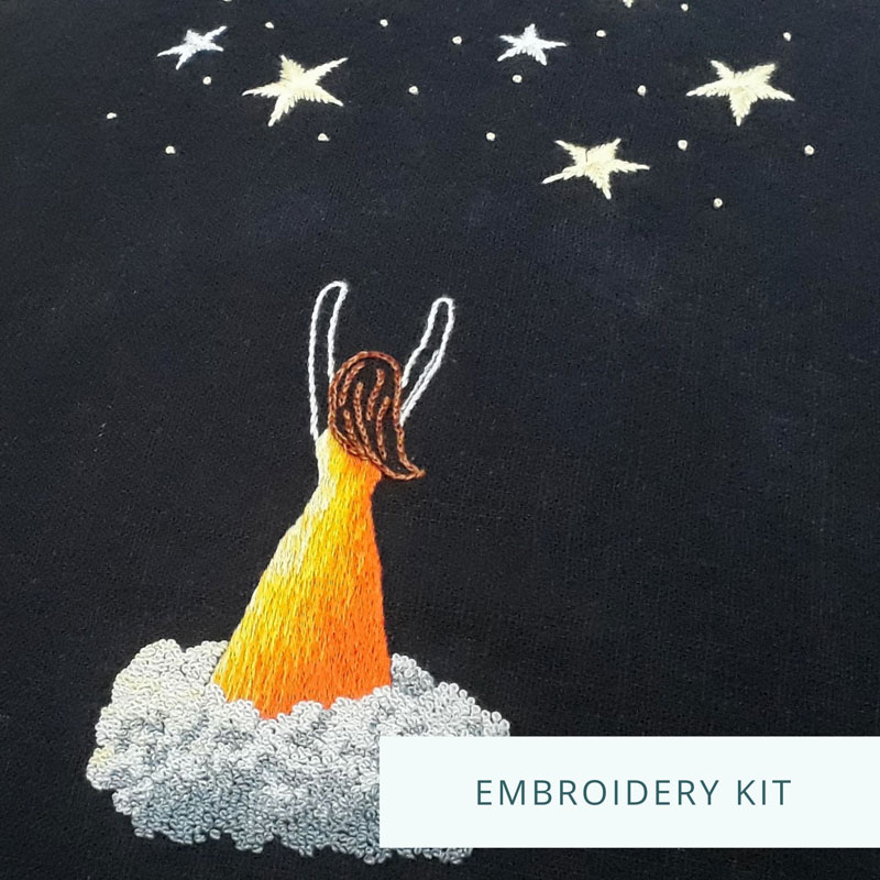 Silk shading embroidery of a woman in an orange dress, standing on a cloud, reaching for stars above her.
