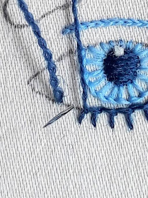 Close up of stitching when changing from buttonhole stitch to stem stitch.